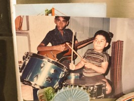 S thaman in childhood- beating drum