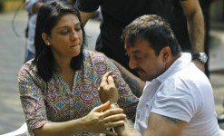 Sister priya dutt comforts an emotional brother sanjay dutt during a news conference outside his residence in mumbai.