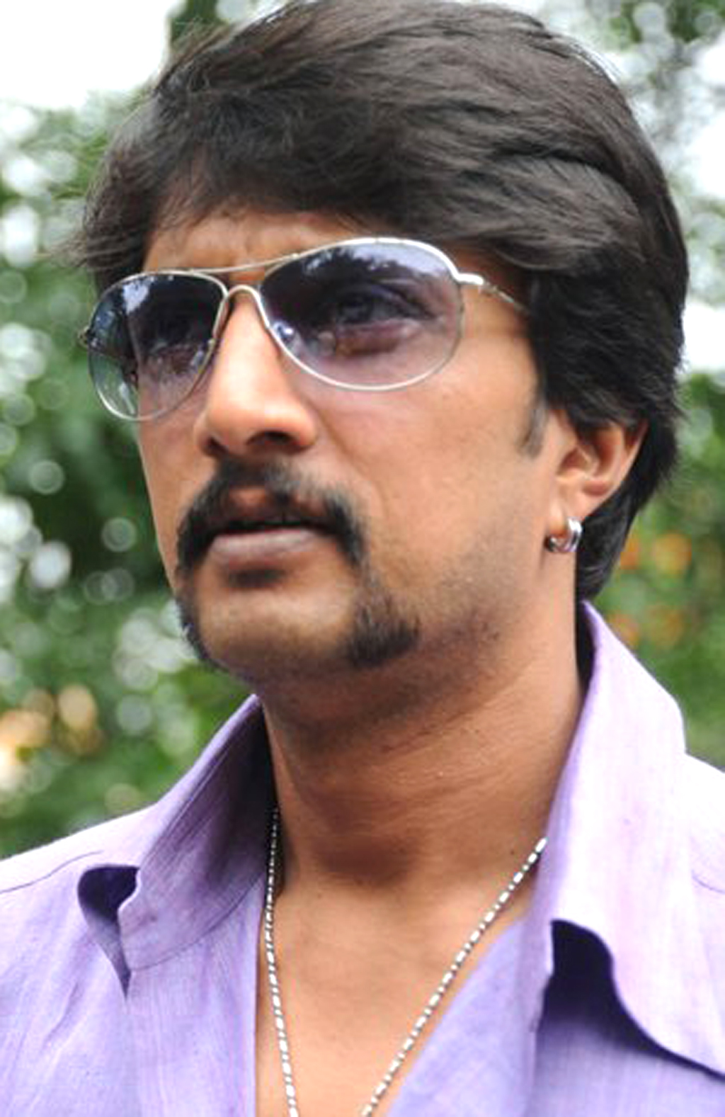 Sudeep images in police dress up