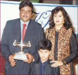 Sumalatha ambarish old family picture: ambarish receiving a prize with his wife and son abhishek