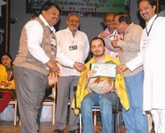 Sunil rao receiving an award